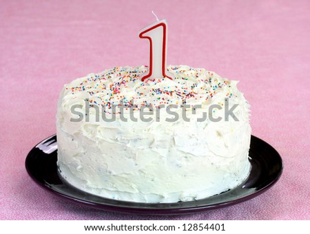 Cake with Number 1 Candle Isolated on Pink - stock photo