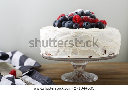 Cake with raspberries and blueberries, dessert - stock photo