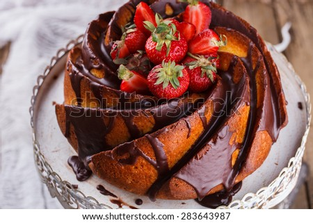 Cake with strawberries and chocolate glaze on the base.selective focus - stock photo