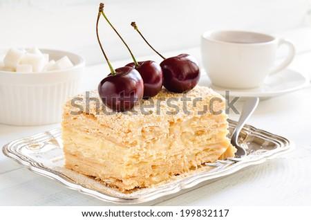 Cake with vanilla custard served with fresh summer cherries - stock photo