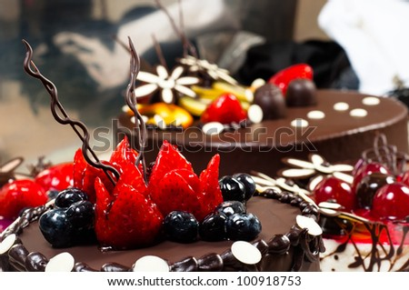 Cakes on blurry background - stock photo