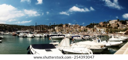 CALA D`OR, MAJORCA, SPAIN - AUGUST 5, 2014: Harbor view in Port of Cala d`Or with boats and buildings on August 5, 2014 in Cala d`Or, Majorca, Spain. - stock photo