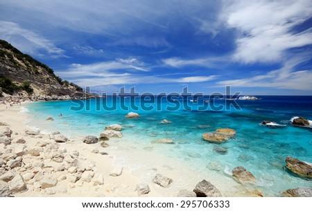Cala di Gabbiani on a clear day with soft white clouds, Sardinia - stock photo