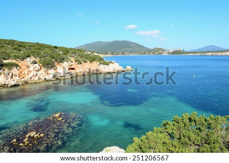 Cala Dragunara under a clear sky. Shot in Sardinia, Italy - stock photo