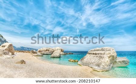Cala Mariolu on a clear day, Sardinia. hdr - stock photo