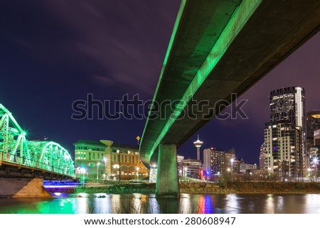 CALAGARY CANAD-MAY 2 2014: 4th Avenue Flyover and the Langevin Bridge at night time in full glow. The city has one of the most colorful light display in Canada, also the oil capital of the country.  - stock photo