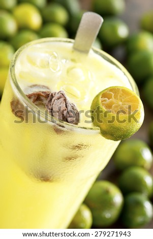Calamansi Limes w Salted Sour Plums - stock photo