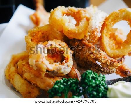 Calamari Rings, Deep Fried Squid, Crispy and Delicious. Food Selective Focus. - stock photo