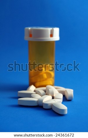 Calcium Pills and Bottle - stock photo