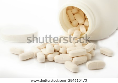 calcium tablets on white background - stock photo