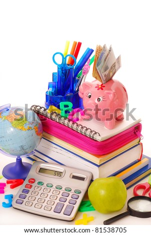 calculating of high costs for equipping the pupil at the beginning of  the school year - stock photo