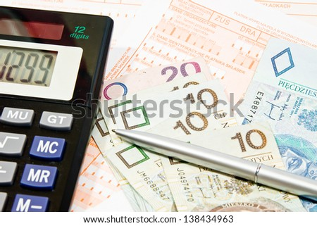Calculating taxes in Poland, PLN currency - stock photo