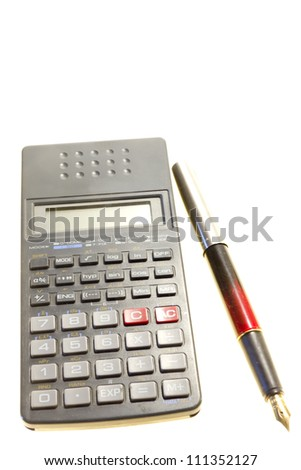 Calculator and a fountain pen isolated on white background - stock photo