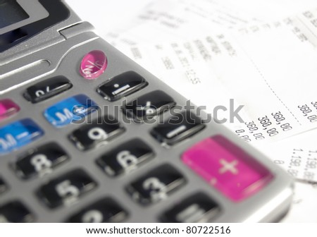 Calculator and bill - stock photo