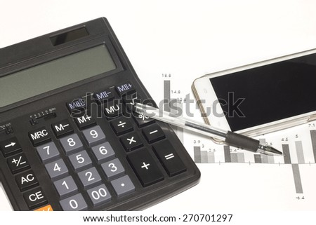 Calculator  and document on the white background. - stock photo