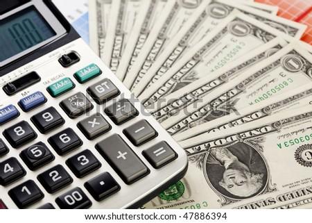 Calculator and dollars - stock photo