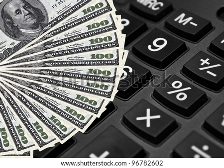Calculator and dollars - Expenses concept - stock photo