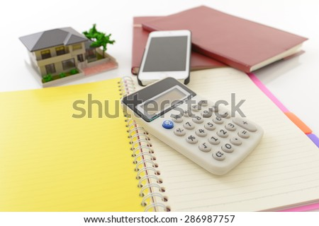 Calculator and house model - stock photo