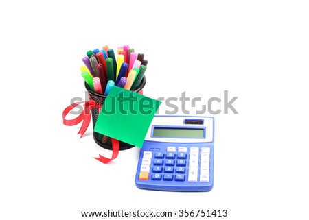 calculator and magic pen in black case with green post it note - stock photo
