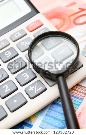 Calculator and magnifier for euro banknotes. - stock photo