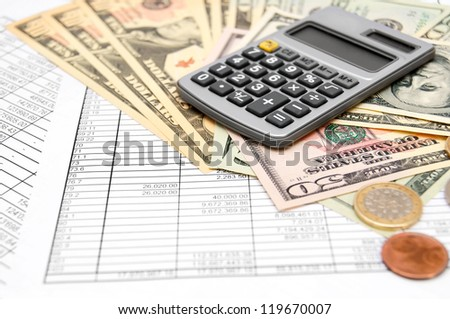Calculator and money on the documents - stock photo