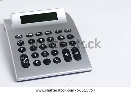 Calculator And paper. Office equpment - stock photo