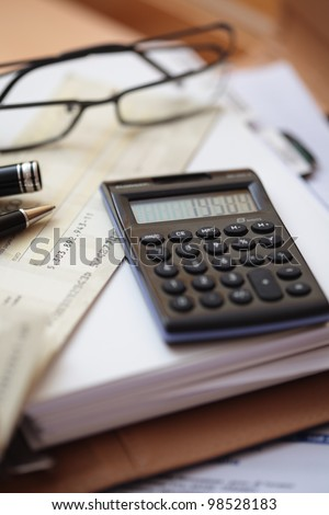 calculator and paper on an office desk - stock photo