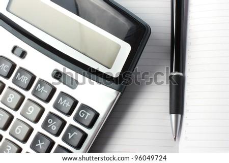 calculator and pen - stock photo