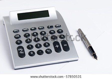 Calculator And pen. Office equpment - stock photo
