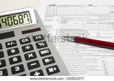 Calculator and pen on a business background - stock photo