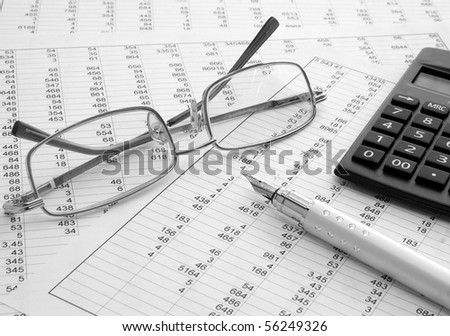calculator and pen on a white background - stock photo