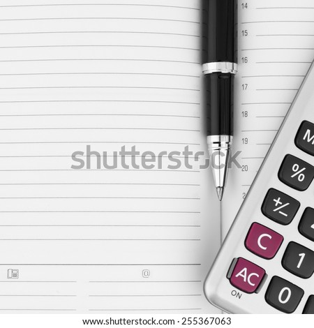 Calculator and pen on notebook close up with space for text - stock photo