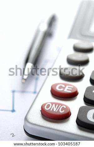 calculator and pen on the table and place for text - stock photo