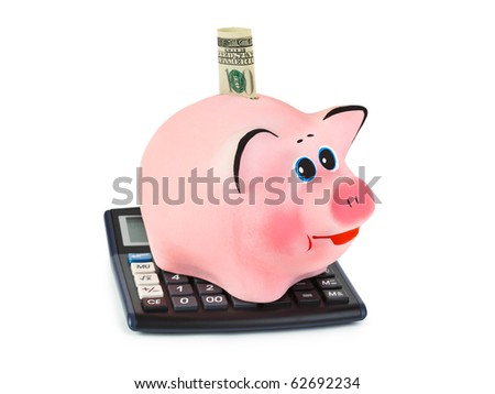 Calculator and piggy bank isolated on white background - stock photo