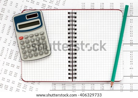 Calculator and spiral notebook on financial statement , concept of accounts. - stock photo
