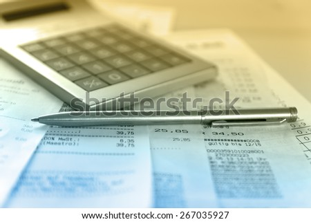 Calculator and the financial report blue toned.Financial accounting - stock photo