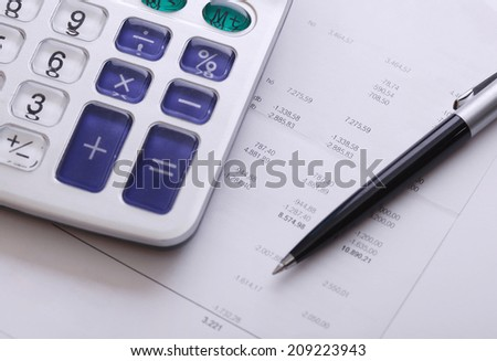 Calculator bill and pen, business and financial issue - stock photo