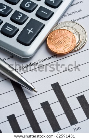 Calculator, coins and pen laying on credit card report.  Concept of finance. - stock photo