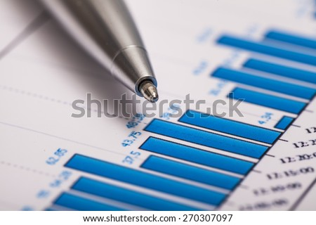 Calculator, graphs, research. - stock photo