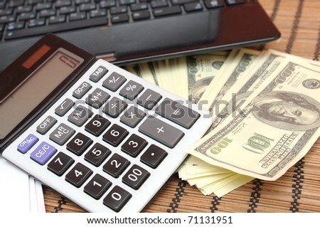 Calculator, money and computer - stock photo