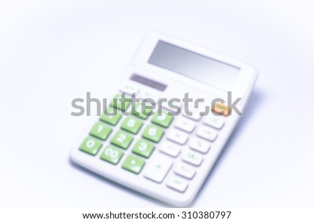 Calculator on a white background: Blur - stock photo