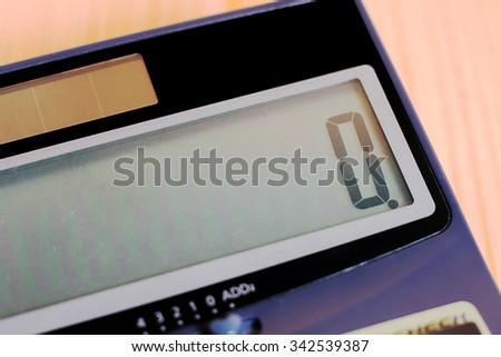 Calculator on a wooden floor - stock photo