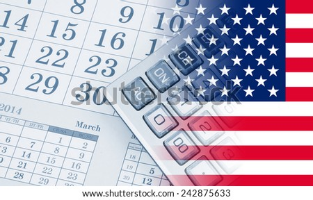 Calculator on calendar background with usa flag - stock photo