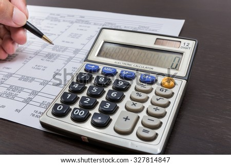 calculator on expenses - stock photo