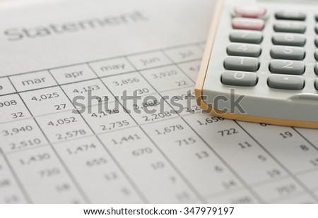 calculator on financial statement on bookkeeper's desk concept of accounts. - stock photo