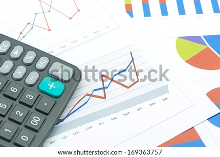calculator on paper table with diagram - stock photo