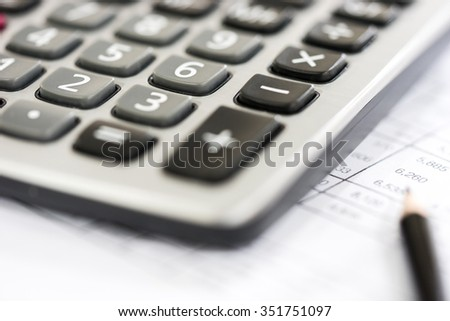 Calculator on the Financial table with pencil - stock photo