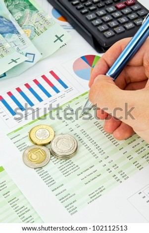 Calculator, pen, coins on a colorful business background - stock photo