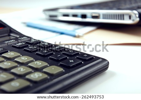 Calculator, pen, folder with documents - stock photo