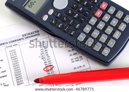 calculator, red pencil and a Invoice - stock photo